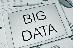 Text big data in the screen of a tablet Royalty Free Stock Images
