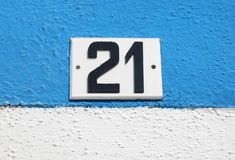 Text with big number 21. Big text number 21 on the wall stock photos