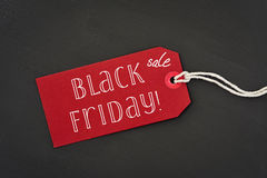 Text black friday sale in a red paper label Stock Photography