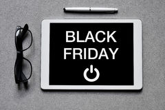 Text black friday in a tablet Royalty Free Stock Image