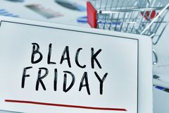 Text black friday in a tablet and a shopping cart Stock Photos