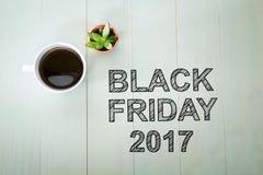 Text Black Fridays 2015 mit einem Tasse Kaffee Lizenzfreie Stockfotografie
