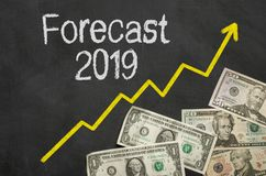 Text on blackboard with money - Forecast 2019 royalty free stock photography