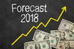 Forecast 2018. Text on blackboard with money - Forecast 2018 stock photo