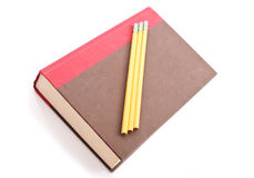 Text Book. Hardcover Book With School Pencils stock photography