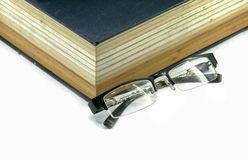Text book or bible with eyeglasses Royalty Free Stock Photo