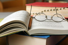 Text books on table. With glasses and pencil stock photography