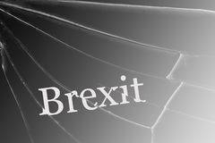 The text Brexit on the broken glass. The concept of a UK exit from the European Union stock images