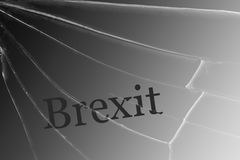 The text Brexit on the broken glass. The concept of a UK exit from the European Union royalty free illustration