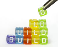 Text build on colorful wooden cubes Stock Photography