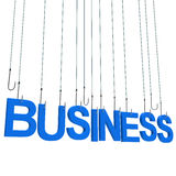 Text BUSINESS hanging on a fishing hook. Stock Photo