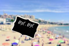 The text bye bye summer in a signboard. The text bye bye summer being written in a black signboard on the beach stock footage