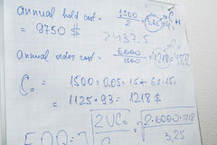 Text of calculations on paper. Text of calculations on the flip chart paper in the office Royalty Free Stock Image