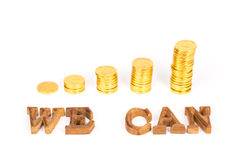 Text WE CAN and gold coin Stock Photography