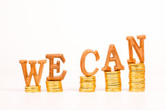 Text WE CAN and gold coin Stock Photos
