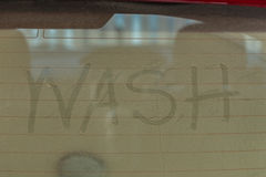 Text of car wash on back mirror Stock Image