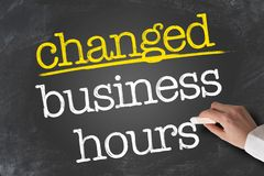 Free Text CHANGED BUSINESS HOURS Written On Chalkboard Royalty Free Stock Images - 146911169