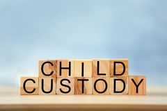 Text CHILD CUSTODY made of wooden blocks Stock Photo