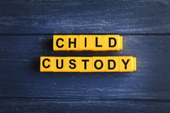 Text CHILD CUSTODY made of yellow blocks Stock Photo
