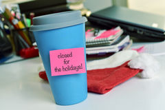 Text closed for the holidays in a mug Royalty Free Stock Image