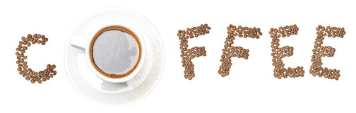 Text coffee arranged in creative way. Text assembled from coffee beans Royalty Free Stock Photography