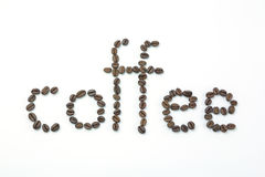 Text coffee by coffee beans Royalty Free Stock Images