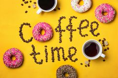 Text coffee time from coffee beans and Donuts. Text coffee time from coffee beans and colorful Donuts Stock Image