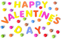 Text of colorful letters Happy Valentines day among multicolored round sweets. Isolated. Text of colorful letters Happy Valentines day on the background of Royalty Free Stock Image