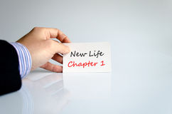 Text concept New life chapter 1. Bussines man hand holding business concept message New life chapter 1 royalty free stock photos