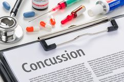 The text Concussion written on a clipboard Stock Image
