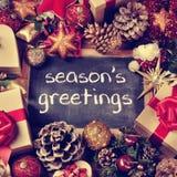 Text cumprimentos das estações, presentes e ornamento do Natal, EFF retro Fotografia de Stock Royalty Free