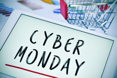 Text cyber monday in a tablet and a shopping cart Royalty Free Stock Image