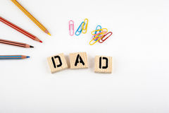 Text: Dad from wooden letterson on white office desk Royalty Free Stock Photo