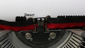 Text Dear Santa written with the old typewriter. Big Text Dear Santa written with the very old typewriter on white sheet stock footage