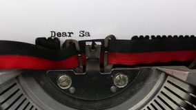 Text DEAR SANTA written with the typewriter. BIG Text DEAR SANTA written with an old vintage typewriter on white sheet stock video footage
