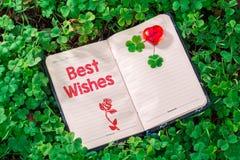 Text der besten Wünsche im Notizbuch stockfoto