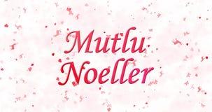 Text der frohen Weihnachten auf Türkisch Mutlu Noeller gebildet vom Staub und von den Drehungen, um horizontal abzuwischen stock footage