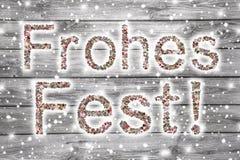 Text der frohen Weihnachten in der deutschen Sprache in Grauem und in weißem Stockfoto
