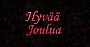 Text der frohen Weihnachten in finnischem Hyvaa-joulua gebildet vom Staub und von den Drehungen, um horizontal abzuwischen stock video footage