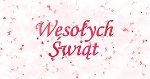 Text der frohen Weihnachten in polnischem Wesolych Swiat gebildet vom Staub und von den Drehungen, um horizontal abzuwischen stock video