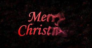 Text der frohen Weihnachten wendet sich an Staub vom Recht auf schwarzem backgroun Lizenzfreie Stockfotos