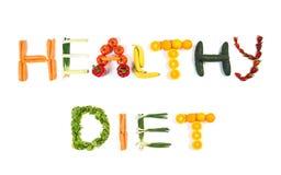 Text der GESUNDEN DIÄT gemacht aus den Obst und Gemüse heraus lokalisiert auf Weiß lizenzfreies stockbild