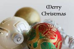 Text der Weihnachtsverzierungen und der frohen Weihnachten Stockfoto