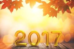 Text des Gold2017 auf altem Holz auf Rotahorn im hellen Hintergrund des Herbstes und des bokeh lizenzfreie stockfotos