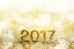 Text des Gold-2017 auf Gold-bokeh Stockfoto