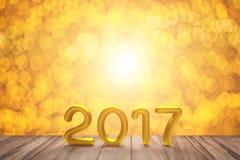 Text des Gold-2017 auf Gold-bokeh Stockfotografie