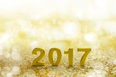 Text des Gold-2017 auf Gold-bokeh Lizenzfreie Stockfotos