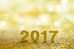 Text des Gold-2017 auf Gold-bokeh Stockfotos