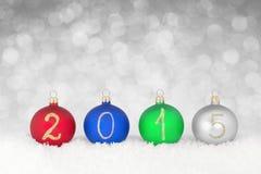 Text des neuen Jahres 2015 auf Weihnachtsflitter Stockbild