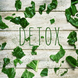 Text detox and chopped raw chard on a rustic white table Royalty Free Stock Photo